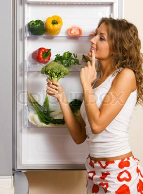 b2ap3_thumbnail_2719963-596443-cheerful-young-woman-taking-vegetables-out-of-fridge.jpg